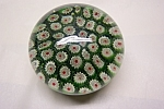 Beautiful Silvestri green milifiori paperweight.  3 inches in diameter and 2-1/4 inches tall.  Sticker on bottom.  As new condition.