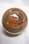 Unique and pretty paperweight with orange, black and white abstract linear pattern made by an Ohio River Valley paperweight artist.  Not signed.  3-1/4 inches in diameter and 2-1/2 inches tall.  As ne...