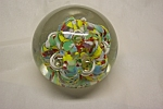 Pretty multi-colored abstract and controlled bubble paperweight made by Brownwood Glass Company (TX).  2-1/2 inches in diameter and 2-1/4 inches tall.  Glass company closed in the 1950s.  Fine conditi...