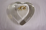 Pretty heart-shaped crystal glass 40th Wedding Anniversary paperweight.  40th is gold plated.  4 inches long, 3-3/4 inches wide and 1 inch thick.  Original sticker on side.  1986.  Free of damage.