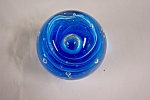 Beautiful glass paperweight with a case abstract blue design containing a large central bubble and smaller surrounding bubbles.  3 inches tall and 3 inches in diameter.  Made by unknown Ohio River Val...