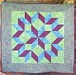 Click here to enlarge image and see more about item QUILT989: Quilted Wallhanging Lime Blue Maroon Carpenters Wheel