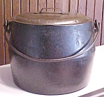 Click here to enlarge image and see more about item T18624: Marietta O. Co. Iron Bulge Cooking Pot & Lid