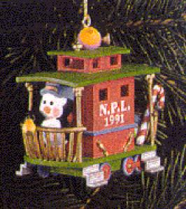 1991 114857-3 #2 Christmas Express Caboose N.P.L. Penguin Conductor M. Gilmore (Image1)