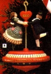 Click here to enlarge image and see more about item CARL37: 1990 102370-5 First 1ST Christmas Together : Wonderland Waltz Red Top  Twirling