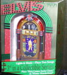 Click here to enlarge image and see more about item CARL9: 1997 #3 ELVIS HOLIDAY HARMONY Light/ Music 'Here Comes Santa Claus' Winter Wonderland