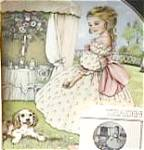 Click here to enlarge image and see more about item CB3: TUESDAY'S CHILD A CHILD'S BLESSING P.Cooper CrownWare Eng China Hamilton Girl Puppy