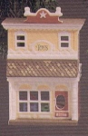 Click here to enlarge image and see more about item HM48: QX497-5 Nostalgic Houses & Shops #2 Old Fashioned Toy Shop Art: Donna Lee QX4975