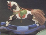 Click here to enlarge image and see more about item HM56: ROCKING HORSE #5 QX493-2 Artist Linda Sickman Brown White Pinto Blue Rockers NB