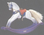 Click here to enlarge image and see more about item HM58: ROCKING HORSE #7 87 QX482-9 Artist Linda Sickman White Charger Purple Rocker MIB