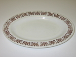 Click here to enlarge image and see more about item CDAHFKF01: Anchor Hocking Fire King Filigree Oval Plate Platter