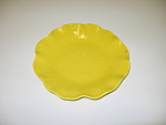 Click here to enlarge image and see more about item CDMPL05: Metlox Poppytrail Lotus Yellow Salad Plate