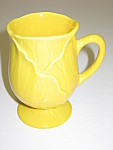 Click here to enlarge image and see more about item CDMPL06: Metlox Poppytrail Lotus Yellow Cup Mug