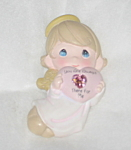 Click here to enlarge image and see more about item FPM01: Precious Moments 1999 Avon Angel Heart Pin Pink Stone