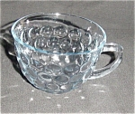 Click here to enlarge image and see more about item 1044s: Fire King Blue Bubble Cup