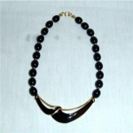 Click here to enlarge image and see more about item 1188: Trifari Black Beaded Goldtone Necklace