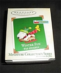 Click here to enlarge image and see more about item 1253s: 2005 Winter Fun With Snoopy Hallmark Ornament