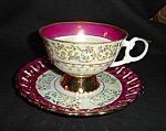 Click here to enlarge image and see more about item 1280s: Japan Luster Cup and Saucer