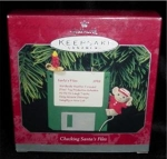 Click here to enlarge image and see more about item 47h: Checking Santa's Files Hallmark Ornament