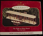 Click here to enlarge image and see more about item 704h: Flight of The Kitty Hawk Hallmark Ornament