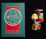Click here to enlarge image and see more about item 720h: 1990 Armful of Joy Hallmark Ornament