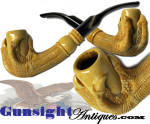 Though it appears to have been smoked at some time, this attractive carved bone tobacco pipe remains in excellent condition with that rich age color that comes to bone only with decades of age and careful handling.  Totally unmarked as to maker, the stem is of natural horn and the quality of work in the eagle claw body will best be described here by our illustrations.  <B>Buy with confidence! </B><I> All direct sales are backed by </I> <B><U>no questions asked</U> three day inspection with return as purchased !</B> <I>Just send us a courtesy  e-mail to let us know your item is being returned per these previsions and your purchase price will be refunded accordingly.</I>  Thanks for visiting Gunsight Antiques !