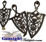 <B>Not</B> to be confused with the usually encountered reproduction in this pattern this example is the <U>real thing</U>.  This genuine antique, cast iron trivet, with its classic patriotic shield design, crossed cannons, cannon balls and crossed swords, measures 8 ½ inches long and is 4 1/8 inches wide.  Never painted this desirable original remains in excellent condition and will make a pleasing addition to any collection. Thanks for visiting Gunsight Antiques !