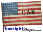 This attractive 48 star GAR stick flag, is printed in the traditional old style on coarse cotton gauze measuring 18 X 10 1/2 inches with the original 30 inch stick. Recovered from a defunct G. A. R. Civil War veteran hall some years ago, we have had a small number of these flags in storage since.  They remain in excellent unused condition yet offer the charm of the early printed construction on coarse gauze expected of these flags from the 1860s through to the earliest c.1912, 48 star flags.  (After about 1913 these stick memorial and parade flags can be expected to be printed on cotton of a much tighter weave.)  Anyway as part of our <I>clean out / pick up</I> effort we are offering the few that we have individually priced while they last.   A nice all original decoration piece without spending a ton of money.  <B>Don't forget to give our search feature a try</B> for special wants. A simple <B>key word</B> in lower case works best.  Thanks for visiting Gunsight Antiques !