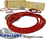 This beautiful 22 inch string of antique salmon coral beads remains on its original fine olive green three strand mounting and is offered as found after decades of storage with an accompanying notation : <I>These coral beads were worn by Delia M. Ting born Sept 1,1843 when she was a small child.</I> and that  <I>They use to think that wearing coral beads aided children in cutting teeth and prevented sore throat etc.</I> Obviously prized as a family heirloom, the penned notation further advises that the beads were likewise worn by Delia�s daughter.  We learned by a rudimentary bit of research that natural coral has been prized in many cultures for centuries for believed medicinal properties.  Small round beads of salmon orange to a deep red were the most prized. It was thought to be effective as an antidote to poison and an efficacious amulet for warding off all manner of negativity.  Coral's protective powers were believed to be especially good for children causing parents to hang tiny coral branches on a child's cradle or place a string of small coral beads around a baby's neck soon after birth to <I>preserve and fasten their teeth</I>.   All in wonderful untouched and original condition these beautiful antique coral beads will fit in any number of categories from antique jewelry to medical collectables.<B>Buy with confidence! </B><I>  We are pleased to offer a <B><U>no questions asked</U> three day inspection with return as purchased on direct sales!</B> <I>Just send us a courtesy  e-mail to let us know your item will be returned per these provisions and your purchase price will be refunded accordingly.</I>  Thanks for visiting Gunsight Antiques!