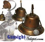 A very scarce <I>camphene</I> lantern burner!  Fashioned from die struck sheet brass with retainer clips for use in the circa 1850 early 1860 fixed globe style lanterns, this lantern burner is intended for use with <U>camphene</U>rather than the usual whale or coal oil fuel commonly used in these old lanterns. Dangerous though it could be due to its volatility, camphene  (a mixture of turpentine and alcohol) gained popularity in the 1850s and early 1860s as it produced a clean burning bright light.  Generally restricted to smaller, stationary lighting devices because of its potentially dangerous volatility, an application such as this one intended for use in the larger portable globe lantern is very unusual. The extra length and small diameter of the wick tube offered an extra measure of separation of flame from fuel reservoir and is a telltale feature of the camphene lighting device. Commonly thought of solely to facilitate extinguishing the flame, the little chain secured cap was in actuality primarily for the prevention of evaporation of the fuel when not on use. ( note: The only lantern we are aware of manufactured for use with camphene is the <I>SARGENT'S PAT. 1861</I> fixed globe lantern.  With some considerable variation from the Sargent's Patent burner though, the subject example was clearly not of Sargent's manufacture and was likely offered as a separate purchase for use with the common fixed globe lantern of the period. ) All in nice original condition this scarce camphene lantern burner is offered just as it came to us, uncleaned and unpolished just as collectors prefer.  <B>Buy with confidence! </B><I>  We are pleased to offer a <B><U>no questions asked</U> three day inspection with return as purchased on direct sales!</B> <I>Just send us a courtesy  e-mail to let us know your item will be returned per these provisions and your purchase price will be refunded accordingly.</I>  Thanks for visiting Gunsight Antiques!
