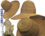 Our photo illustrations will likely do best to describe this beautiful old hat.  Rather crudely woven in comparison to most examples in this material, we'd guess this broad brimmed hat with the classic high<I>bee hive</I> crown that collectors of Southern and Western antique headgear love, was truly <I>home-made</I> as opposed to the finer bear grass work usually associated with Native American basketry.  Done in a <I>soft weave</I> so as to be pliable and facilitate air flow, this beautiful old slouch hat, crude though it's weave is, remains as solid as it must have been in its inception.  The brim measures a full 17 inches in diameter and the <I>hat size</I> would fall in the modern day <I>medium</I> (approximately 21 inches diameter).  The cotton sweatband measures 1 ¾ inch wide.    