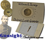 This <I>R. W. ROBINSON * EXTRA RICH</I> back marked <B><I>LG</B></I> uniform coat button was used by the <B>Detroit Light Guards</B> in the pre Civil War era then was carried into the war as volunteers of that home guard became members of Co. A <B> 1st Michigan Volunteers</B>.  Removed from its display card for our photography and to show the maker markings, the button was then placed back on its mount utilizing the same wood sliver to secure it in place as when we acquired the piece. The button came to us on the <I><B>William A. Throop  Detroit Light Guards</I></B> display card emanating from a G.A.R. grouping. 