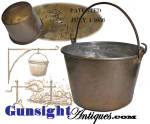 Measuring 9 ¾ inches in diameter at its mouth while standing just over 6 inches to its rim with a slight taper to a 7 3/8 inch diameter base, this brass cook pail is designed for use over an open fire with an <U>oval rather than flat bottom</U> with a hand wrought iron bail handle for suspension.  The bottom bears a partial makers identification with a patent date of 1851 still discernible. Our research found that the kettle was manufactured by the <I>Ansonia Brass and Battery Company</I> (<I>battery</I> being the term then in use for hammering sheets of metal into kettles).  The company was founded in Ansonia, Connecticut in 1844. The inner surface of the pail retains the most of an original tinning.  (This feature and the rounded bottom are likely the basis for the 1851 patent.)  Entirely original and in pleasing condition with a rich untouched age patina to all surfaces and good evidence of period use, this piece will go well with any open hearth and will set in nicely in any period antique environment.  <B>Don't forget to give our search feature a try</B> for special wants. A simple <B>key word</B> in lower case works best. Thanks for visiting Gunsight Antiques !!