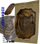 This early Massachusetts Militia Shako Plate remains in excellent plus original condition with an attractive natural age patina that sets off exceptionally fine detail of its deeply struck die work.  Struck from sheet copper 4 ½ inches high with a tin plume holder and two fastening eyes on the back, this outstanding plate emanates from the James Hart collection and comes with Hart's original card display mount.  Hart's long time dedication to the collection of antique American military insignia will be familiar to collectors in this field as examples were displayed and extensively published.  (see: acknowledgements & credits: Campbell and O'Donnell - <I>American Military Headgear Insignia </I>) An outstanding acquisition opportunity for the early American insignia enthusiast!  <B>Buy with confidence! </B><I>  We are pleased to offer a <B><U>no questions asked</U> three day inspection with return as purchased on direct sales!</B> <I>Just send us a courtesy  e-mail to let us know your item will be returned per these provisions and your purchase price will be refunded accordingly.</I>  Thanks for visiting Gunsight Antiques!