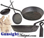 A staple of the Civil War troops campfire, these classic sheet iron skillets were much lighter in weight, more durable and though they would not hold the heat as long as the more conventional cast iron fry pan of the period, this lighter, easier to carry, version would heat to cooking temperature much faster and with less fire.  These attributes made the  simple <I>blacksmith</I> skillet, formed from a single sheet of high carbon <I>black-iron</I> with its riveted on forged iron handle, just the thing at company mess.  Common though they were  (see: Howard Crouch's <I>Excavated Civil War Artifacts - A Guide for the Historian</I>) they saw hard use with surviving, non-excavated examples, seldom seen on today's market.  This example is all original with that distinctive patina that comes to the old high carbon black iron with repeated use and decades of age.  Measuring 7 3/4 inches across its base with its 2 inch high sides flaring out to form a pan of approximately 9 3/8 inches in diameter, this classic example of camp cook ware will go well in any period grouping. As with <U>all direct sales</U>, we are pleased to offer a <B>no questions asked three day inspection with refund of the purchase price upon return as purchased!</B> Thanks for visiting Gunsight Antiques !
