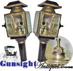 This exceptional pair of carriage lamps show little if any evidence of use while offering unquestionable age and originality both in condition and unmistakable mid 19th century tinsmith construction of the matching lantern bodies.  Each lamp measures approximately 12 inches in height with heavy, approximately ¼ inch thick, beveled glass <I>lenses</I> measuring 3 7/16 X  3 7/8 inches each.  Outer surfaces are of black enamel with naturally patinated brass trim and chimney.  Internal reflector surfaces are bright nickel silver plate with plated burner marked <B>E. MILLER & Co. Meriden, Conn. </B>  [ Edward Miller began manufacturing and selling camphene and lantern fluid burners in Meriden, Connecticut in the 1840's.  By the 1860's  <I>E. Miller & Co.</I> had become a successful manufacturer and marketer in the kerosene lamp and lamp burner business with the latter being merchandized to private lighting makers.  In 1866 Miller reorganized under the name <I>Edward Miller & Co.</I> or <I>E M & Co</I>. ]  Easily displayed utilizing original mounting sockets, this exceptional matching pair of carriage lamps remain complete and in exceptional condition with pleasing evidence of age and originality.  <B>Buy with confidence! </B><I>  We are pleased to offer a <B><U>no questions asked</U> three day inspection with return as purchased on direct sales!</B> <I>Just send us a courtesy  e-mail to let us know your item will be returned per these provisions and your purchase price will be refunded accordingly.</I>  <FONT COLOR=#0000FF>Thanks for visiting Gunsight Antiques! :</FONT COLOR=#0000FF>