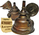 This neat little spun brass finger lamp stands approximately 4 inches high and measures approximately 3 ¼ inches in diameter at the base. The wick adjustment wheel sports a <B>Pat. June 23, 1863</B> patent date.  Fashioned of spun brass with a tin bottom, this little oil lamp will need a wick if you intend to use it but is otherwise in pleasing condition yet with good evidence period use and an attractive untouched dark age patina.  A nice item for the Civil War collector or lighting enthusiast.  <B>Buy with confidence! </B><I>  We are pleased to offer a <B><U>no questions asked</U> three day inspection with return as purchased on direct sales!</B> <I>Just send us a courtesy  e-mail to let us know your item will be returned per these provisions and your purchase price will be refunded accordingly.</I>  <FONT COLOR=#0000FF>Thanks for visiting Gunsight Antiques! :</FONT COLOR=#0000FF>