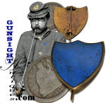 Organized in April of 1863 the shield device of the 23rd Army Corps was standardized and officially adopted by Special Field Order No. 121 issued September 25, 1864. Illustrated here with a quarter for size comparison, this brass shield badge of the 23rd Army Corps with its blue porcelain insert of the 3rd Division sports the classic <B>T</B>hinged fastening pin that Civil War collectors look for in dating corps badges and id pins.  Recently acquired from an old collection put together when such quality could be found, this examples remans in fine condition.  <B>Buy with confidence! </B><I>  We are pleased to offer a <B><U>no questions asked</U> three day inspection with return as purchased on direct sales!</B> <I>Just send us a courtesy  e-mail to let us know your item will be returned per these provisions and your purchase price will be refunded accordingly.</I>  <FONT COLOR=#0000FF>Thanks for visiting Gunsight Antiques! :</FONT COLOR=#0000FF>