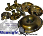 Original Civil War vintage lighting commonly referred to as <I>donut</I> candlesticks because of their appearance and size when collapsed and screwed together for travel.  This offering is a complete four piece set from spun brass with the two screw together drip pans and two holder pieces.   These traveling candleholders are approximately 3 5/16 inches in diameter and remain in excellent condition, unpolished with good evidence of age, originality and careful period use and carrying.  A favorite of the space and weight conscious soldier who carried all he had on his back or in his haversack, original examples  have become equally prized by lighting, Americana and Civil War collectors wishing to round out a display with that special personal look.   Relatively available just a few years ago original. complete examples of these <I>donut</I> candlesticks have become difficult to find on today's collector market. <B>Buy with confidence! </B><I>  We are pleased to offer a <B><U>no questions asked</U> three day inspection with return as purchased on direct sales!</B> <I>Just send us a courtesy  e-mail to let us know your item will be returned per these provisions and your purchase price will be refunded accordingly.</I>  Thanks for visiting Gunsight Antiques!