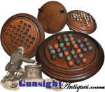 An attractive <I>General Grant</I> board game turned from American walnut with a full complement of 32 period handcrafted clay marble game pieces.  This example measures approximately 8 7/8  inches in diameter and remains in pleasing condition yet with good evidence of period use.   A similar to the old <I>Fox & Geese</I> peg board solitaire game that was so popular in the period of the American Revolution, this game was played utilizing marbles rather than pegs as with its earlier cousin but with the same principal of jumping one game piece with another.   A successful player would finish the game with only one game piece left on the board.  A popular solitaire game of strategy among the military, the Civil War era marble variation became commonly known as the <I>General Grant Game</I> as it was a favorite diversion of the hard drinking cigar smoking Civil War Union Commander.  This  outstanding example is in pleasing condition with a <U>full complement of period clay marbles</U>.   <B>Buy with confidence! </B><I>  We are pleased to offer a <B><U>no questions asked</U> three day inspection with return as purchased on direct sales!</B> <I>Just send us a courtesy  e-mail to let us know your item will be returned per these provisions and your purchase price will be refunded accordingly.</I>  <FONT COLOR=#0000FF>Thanks for visiting Gunsight Antiques! </FONT COLOR=#0000FF>