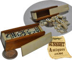 Illustrated here with a period quarter for size comparison these early <I>pocket</I> or <I>haversack</I> size bone domino sets are seldom found complete with all 28 game pieces.  This rare example not only remains complete but has survived all these years in fine, nearly unused, period original condition.  A nice item in any quality Civil War era <I>smalls</I> collection.   <B>Buy with confidence! </B><I>  We are pleased to offer a <B><U>no questions asked</U> three day inspection with return as purchased on direct sales!</B> <I>Just send us a courtesy  e-mail to let us know your item will be returned per these provisions and your purchase price will be refunded accordingly.</I>  <FONT COLOR=#0000FF>Thanks for visiting Gunsight Antiques! </FONT COLOR=#0000FF>