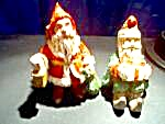 Vintage Two Plastic Wood Like Santa's
