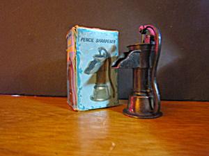 Vintage Die-Cast Miniture Hand Pump Pencil Sharpener  (Image1)