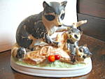 Click here to enlarge image and see more about item afa10b: Vintage Porcelain Raccoon Family Figurine
