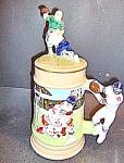 Click here to enlarge image and see more about item st14l: Vintage Football Stein With Lid Green & White