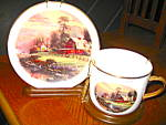 Click here to enlarge image and see more about item tomk1d: Sunset Cup and Saucer Set on Display Rack