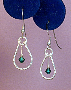 Swarovski Emerald & Twisted SS earrings (Image1)