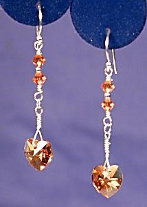 SS & Swarovski Topaz Hearts earrings (Image1)