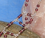 Click here to enlarge image and see more about item BRG004: Sterling Silver & Garnet & 'N' Bracelet