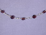 Click to view larger image of Garnet Coin & SS Figure 8 bracelet (Image1)